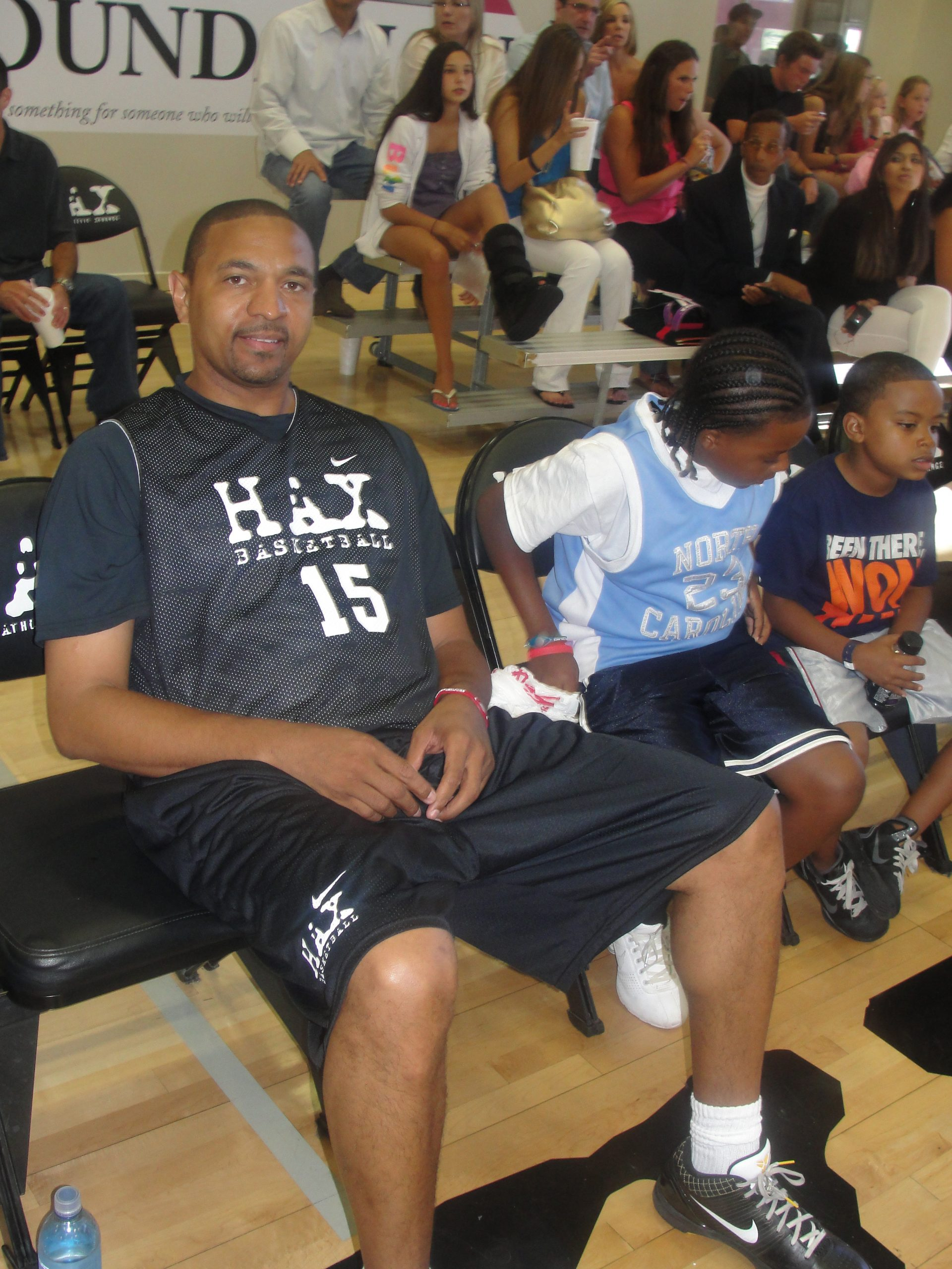 Former NBA great Mark Jackson relaxes for a spell at the John Wooden Memorial Celebrity Basketball Game in Hawthorne, California./Photo by Dennis J. Freeman