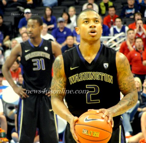 University of Washington player Isaiah Thomas sets his eyes on making his freethrows./Dennis J. Freeman