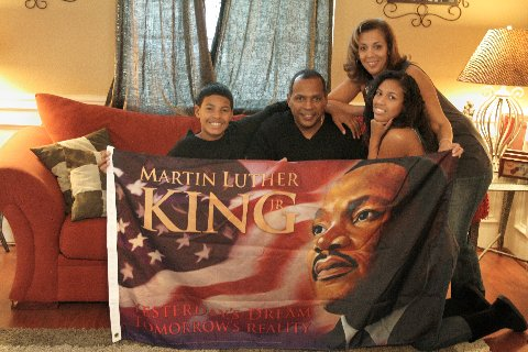Dwayne and Maria Ross embrace the Dr. Martin Luther King Jr. flag they created.