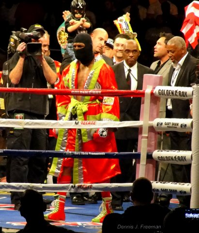 Bernard Hopkins enters the ring wearing a ski mask before facing off against Chad Dawson for a light heavyweight title fight in Los Angeles./Photo/Dennis J. Freeman
