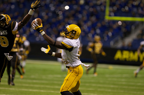 Wide receiver Dorial Green-Beckham (Hillcrest H.S., Springfield, Mo.), the Army Player of the Year, needs just one hand to haul in a long touchdown pass from quarterback Cyler Miles.
