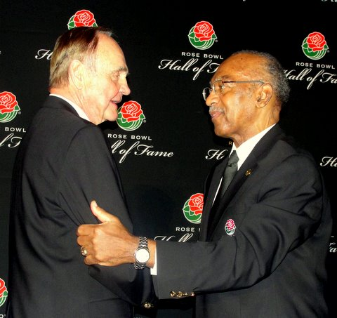 Former Washington Senator George Fleming (right) and legendary sports broadcaster Dick Enberg salute each at the Rose Bowl Hall of Fame ceremony./Photo Credit: Dennis J. Freeman