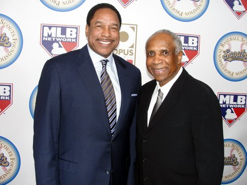 Living Legends: Major League Baseball Hall of Fame members Dave Winfield are all smiles at the Professional Baseball Scouts Foundation gala in Los Angeles.Photo Credit: Dennis J. Freeman