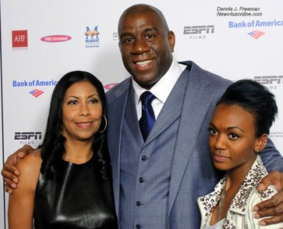 """Former NBA superstar and business leader Earvin """"Magic"""" Johnson, hugs wife, Cookie Johnson and daughter Elisa at ESPN Film's premiere of """"The Announcement."""" Photo: Dennis J. Freeman"""