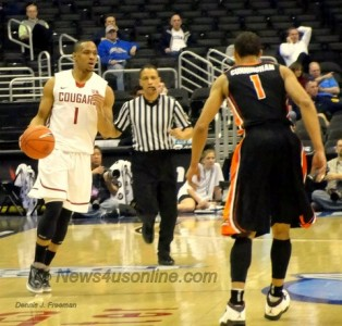 Oregon State guard Jared Cunningham (1) is about to supply some defense on Washington State playmaker Reggie Moore. Photo: Dennis J. Freeman
