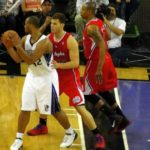 Blake Griffin and Caron Butler apply stiff defense on Chuck Hayes of the Sacramento Kings. Photo: Dennis J. Freeman