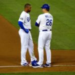 L.A. Dodgers centerfielder Matt Kemp and third base coach Tim Wallach confer on base running strategy in a game against the San Francisco Giants. Photo Credit: Dennis J. Freeman