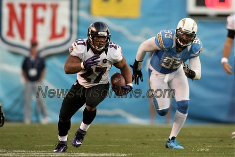 Baltimore Ravens running back leaves san Diego Chargers defensive end Shaun Phillips in his dust. Photo Credit: J. Gaede