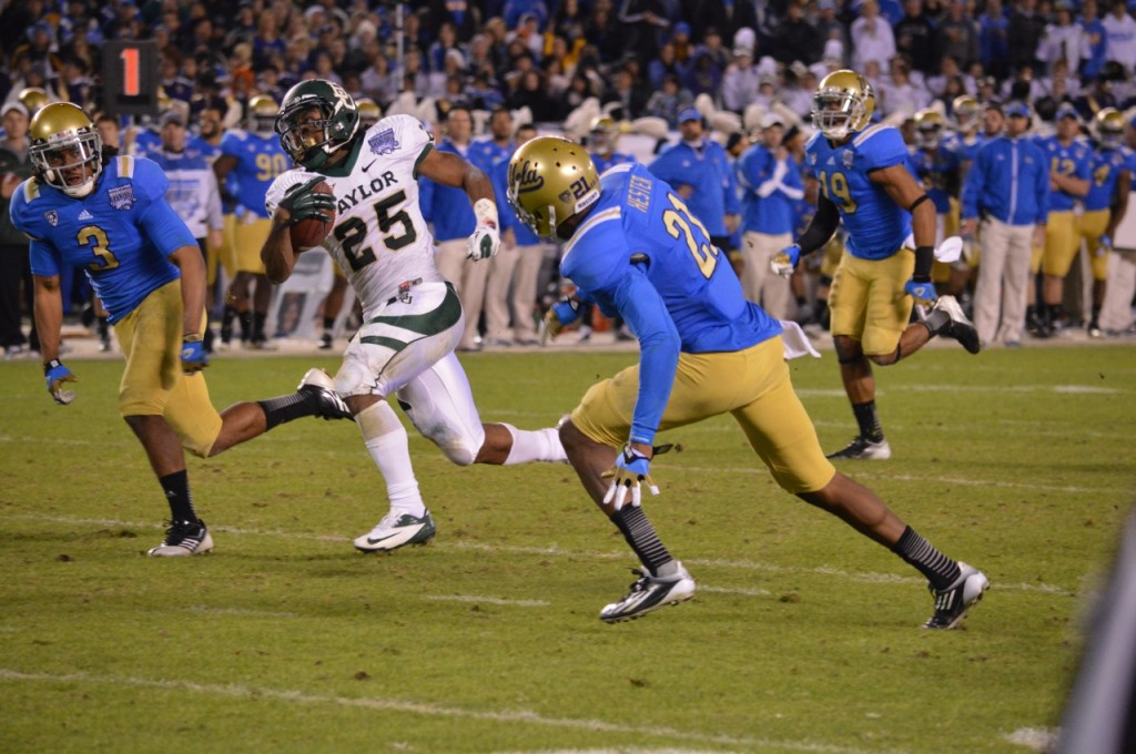 Gotta go: Baylor running back Lache Seastrunk for some of his game-high 139 yards against UCLA in the Bridgeport Education Holiday Bowl. Photo Credit: Ronald Jenkins