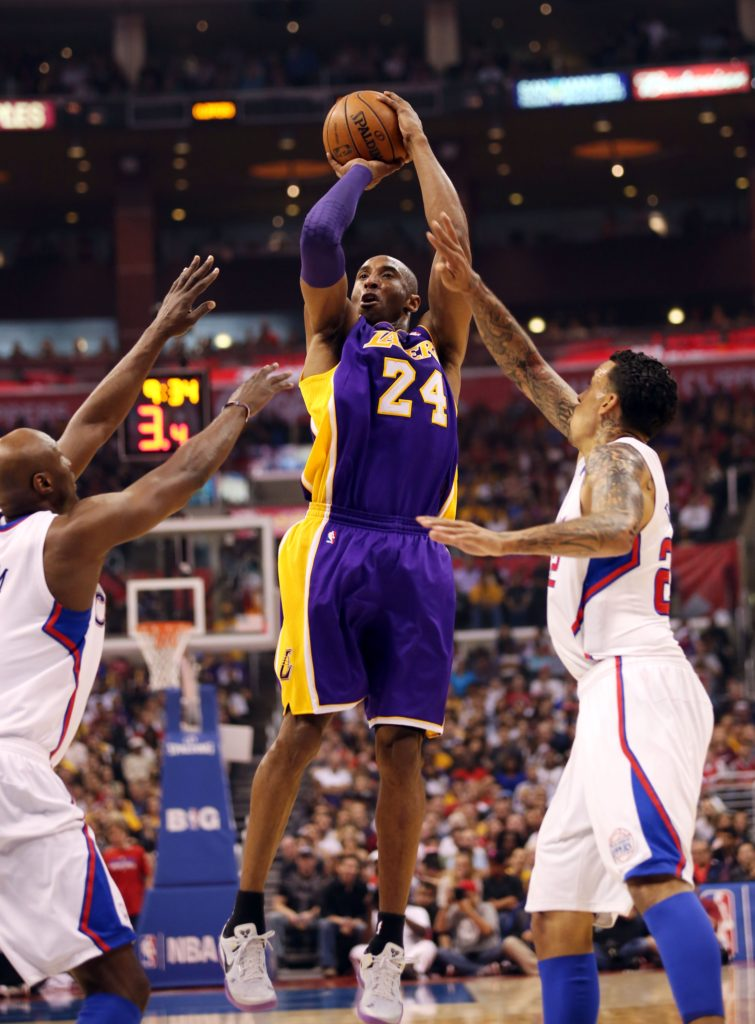 Lakers guard Kobe Bryant puts up the jumper over Clipper defenders reserves Jamal Crawford and Matt Barnes as the Los Angeles Clippers defeat their cross the hall rivals the Los Angeles Lakers 109-95, on Sunday, April 7, 2013, at the Staples Center in Los Angeles, California. BURT HARRIS/PI