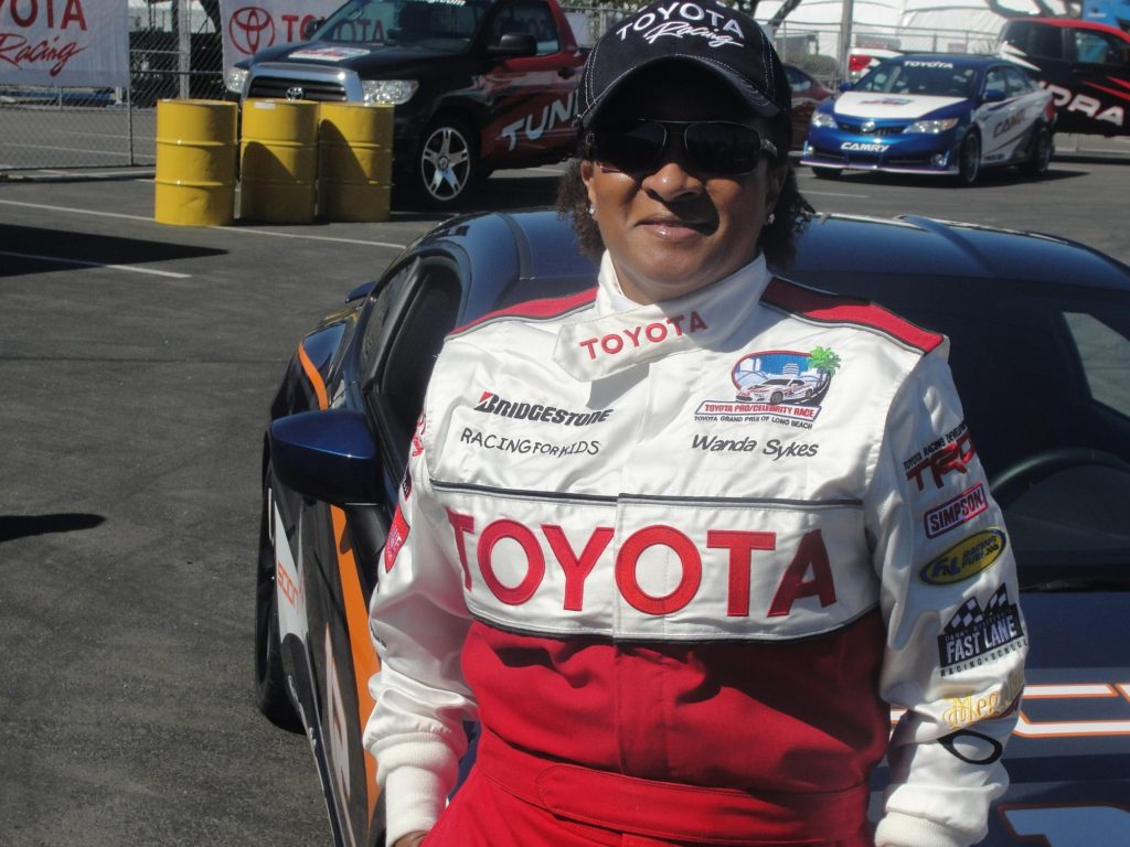 Comedian Wanda Sykes chills out for a moment in between practice runs in preparation for the upcoming Toyota Grand Prix of Long Beach Pro/Celebrity Race. Photo Credit: Dennis J. Freeman