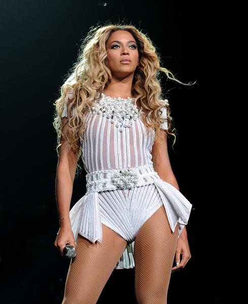 "IMAGE DISTRIBUTED FOR PARKWOOD ENTERTAINMENT - Singer Beyonce performs on her ""Mrs. Carter Show World Tour 2013"" at Staples Center on Monday, July 1, 2013, in Los Angeles. Beyonce is wearing a custom hand beaded peplum one-piece by Ralph & Russo with shoes by Stuart Wieztman. (Photo by Frank Micelotta/Invision for Parkwood Entertainment/AP Images)"