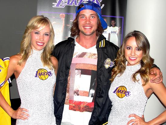 Olympic skier Rory Bushfield with a couple of Laker Girls cheerleaders. Photo: Dennis J. Freeman