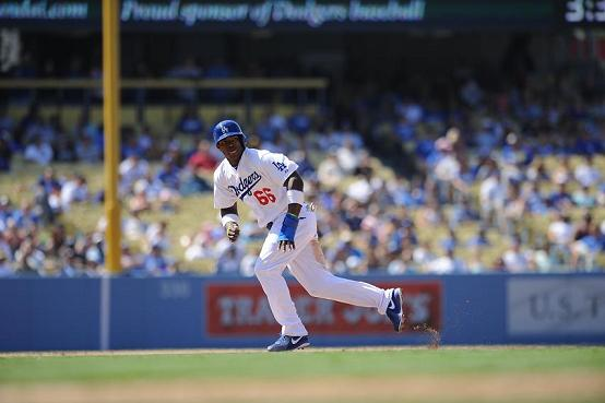 Yasiel Puig is setting Major League Baseball on fire. Photo Credit: Juan Ocampo