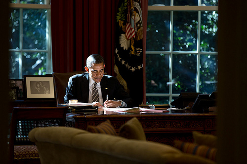 """Light matters. The paper that the President was writing on provided some fill light as he worked at the Resolute Desk in the Oval Office.""  (Official White House Photo by Pete Souza)"