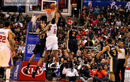 Going to get it:  DeAndre Jordan goes after one of his 14 rebounds against the Utah Jazz on the eve of the SuperBowl. Photo Credit: Dennis J. Freeman/News4usonline.com