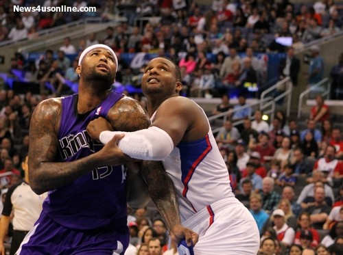 "DeMarcus Cousins of the Sacramento Kings and Glenn ""Big Baby"" Davis wrestle for position during a game played at STAPLES Center. The Clippers defeated the Kings 117-101. Photo Credit: Dennis J. Freeman/News4usonline.com"