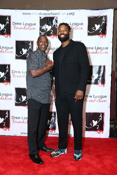 Drew League Foundation Honorary Board Member and former NBA player Baron Davis (right) attends the foundation's awards gala.