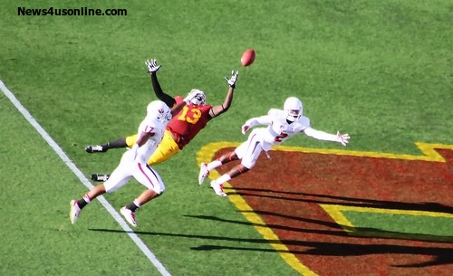 Freshman tight end Bryce  Dixon is airborne against Fresno State. Photo: News4usonline.com