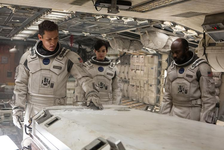 eft to right: Matthew McConaughey, Anne Hathaway, and David Gyasi in INTERSTELLAR, from Paramount Pictures and Warner Brothers Pictures, in association with Legendary Pictures.