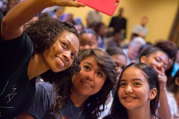 Allyson Felix takes a selfie with students at the 2014 ACTS College Summit in Los Angeles, CA. CREDIT: Udodirim Asomugha for The Asomugha Foundation