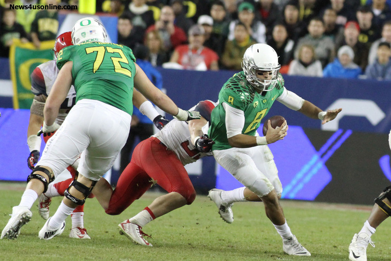 Heisman Trophy frontrunner Marcus Mariota (8) passed for 313 yards and two touchdowns to lead Oregon to a 51-13 win in the Pac-12 championship game against Arizona. Photo Credit: Jevone Moore/News4usonline.com