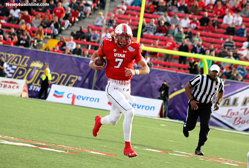 Utah quarterback Travis Wilson on the move against Colorado State in the 2014 Royal Purple Las Vegas Bowl. Photo Credit: Dennis J. Freeman/News4usonline.com