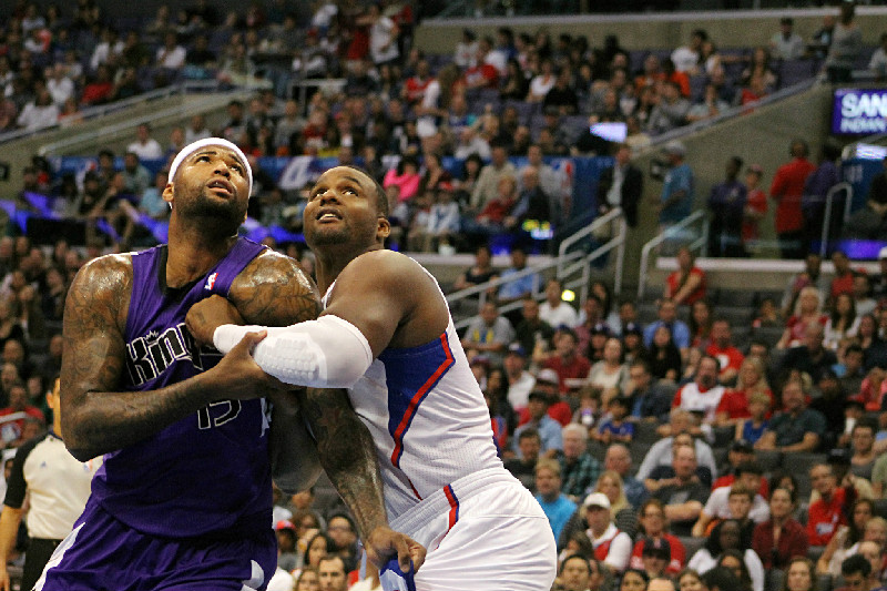 "One of those nights: Sacramento center DeMarcus Cousins and Glen "" Big Baby"" Davis battle in the paint for a rebound during a 2013-2014 regular season game played  at Staples Center. Davis and the Clippers defeated the Kings 126-99 Saturday, Feb. 21, 2015. Photo by Dennis J. Freeman/News4usonline.com"