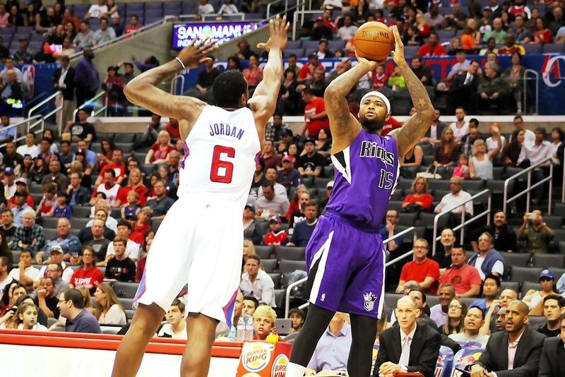 Sacramento Kings center DeMarcus Cousins has the best all-around game of any player at his position. The Kings star, shooting over the LA Clippers DeAndre Jordan in a 2014 game, is averaging 24 points and 12. rebounds a game this season. Photo Credit: Dennis J. Freeman/News4usonline.com