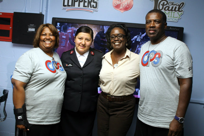 Robin (far left) and Charles Paul (far right) representing the Chris Paul Family Foundation at the Salvation Army Compton Center.