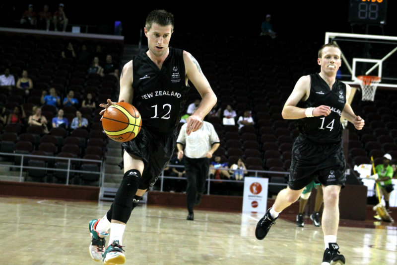 A New Zealand player gets down the court against Saudi Arabia Sunday, July 26, 2015. Photo by Dennis J. Freeman