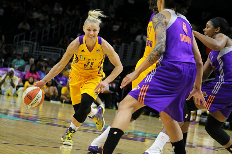Guard Erin Phillips on the move against the Phoenix Mercury Sunday, July 5, 2015. Phillips scored 20 for the Sparks in the team's 94-91 defeat to Phoenix. Photo by Dennis J. Freeman