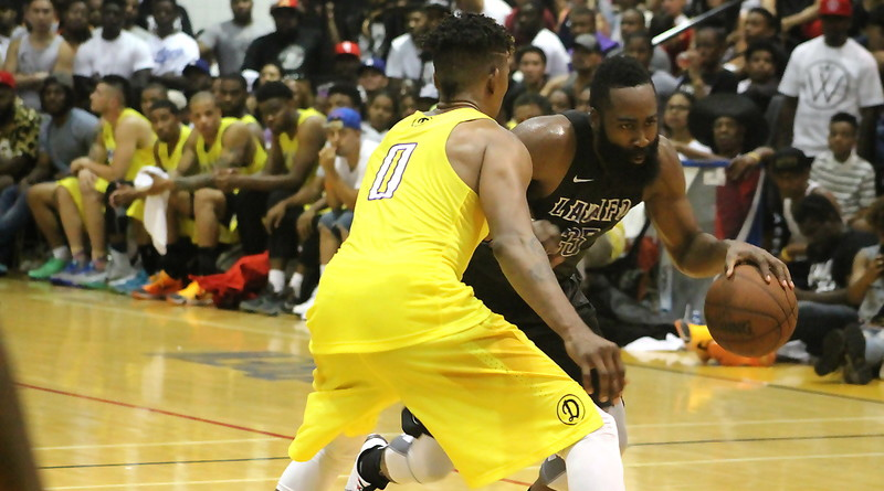 Houston Rockets star forward James Harden attempts to drive by Nick Young of the Los Angeles Lakers during the Drew League championship game on Sunday, Aug. 9, 2015. Photo by Dennis J. Freeman