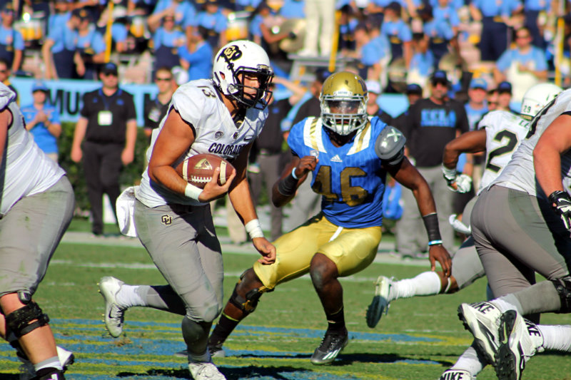 Colorado quarterback Sefo Lufau rushed for 51 yards against the Bruins. Photo by Dennis J. Freeman/News4usonline.com