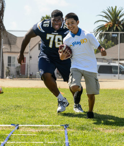 Offensive lineman D.J. Fluker participates in the Jr. Chargers Training Camp recently. Photo courtesy of the San Diego Chargers