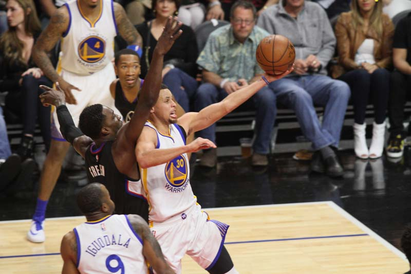 Golden State's Steph Curry goes in for two of his 23 points against the Los Angeles Clippers Saturday, Feb. 20, 2016. Photo by Kevin Reece/News4usonline.com
