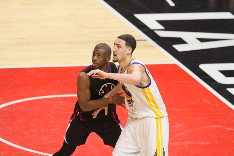 Chris Paul applying defense on Golden State guard Klay Thompson during the Warriors' 115-12 win at Staples Center Saturday, Feb. 20, 2016. Photo by Kevin Reece/News4usonline.com