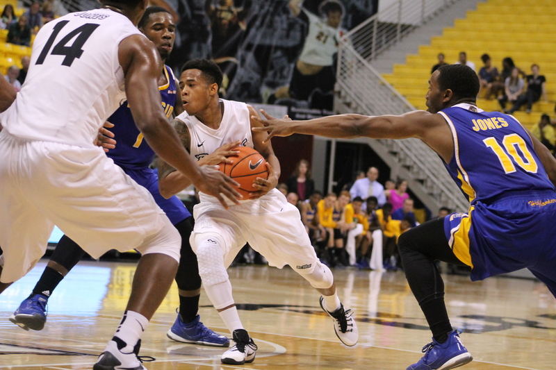 Long Beach point guard Justin Bibbins doing work against UC Riverside in the 49ers' 66-55 win.