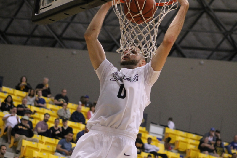 Gabe Levin goes for a dunk against UC Riverside in a Big West Conference game.