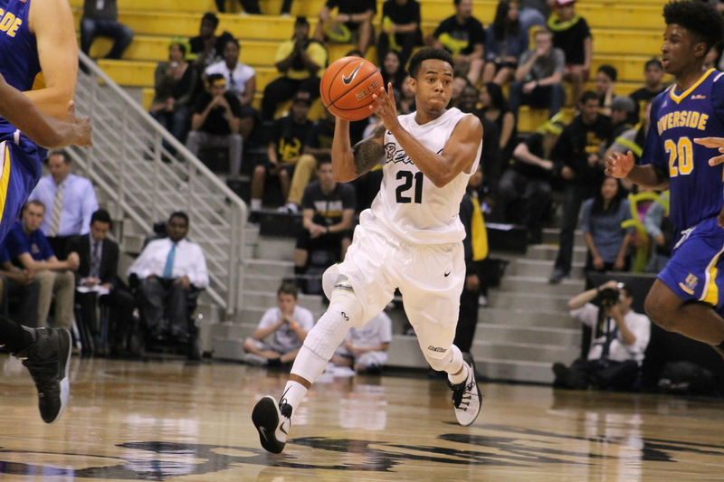 Long Beach State point guard Justin Bibbins leads the fastbreak against UC Riverside.