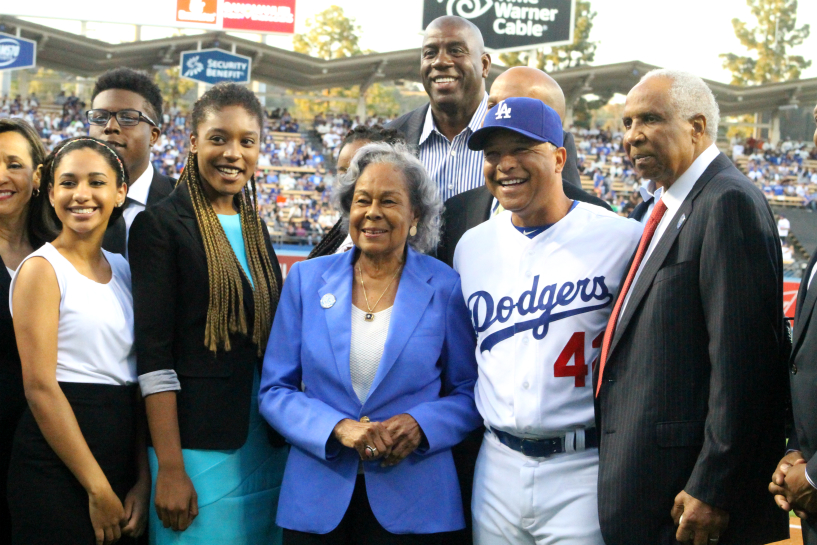 Mrs. Jackie Robinson, Rachel Robinson (third center), Los Angeles Dodgers manager Dave Roberts, team owner Magic Johnson and Hall of Famer Frank Robinson help celebrate Jackie Robinson Day on Friday, April 15, 2016. Photo by Dennis J. Freeman/News4usonline.com