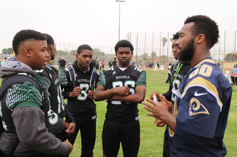Rams linebacker Cameron Lynch speaks to members of the Inglewood Sentinels football team during the Rams Play 60 Field Day event at Coleman Stadium in Inglewood, California. Photo by Dennis J. Freeman/News4usonline.com