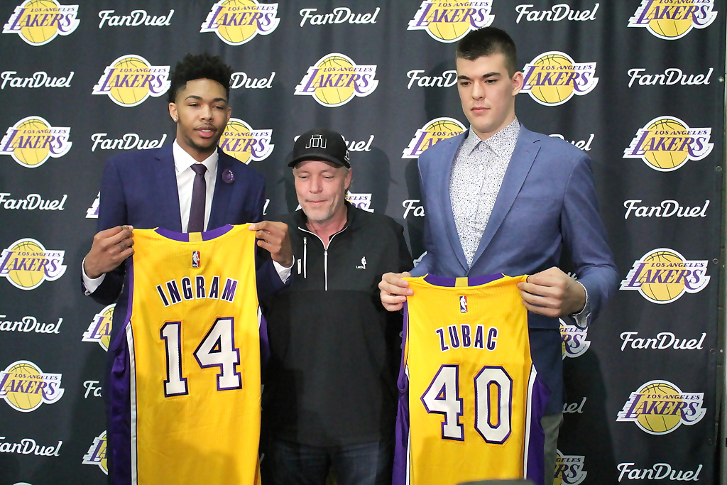 Los Angeles Lakers rookies Brandon Ingram (left) and Ivaca Zubac surround Jim Buss during their introductory press conference at the team's practice facility. Photo by Dennis J. Freeman/News4usonline