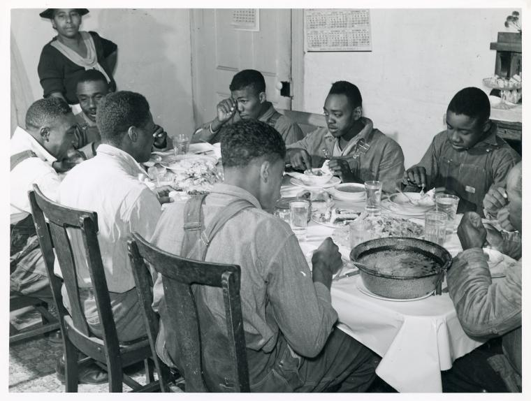 The Negro tenants and neighbors eating dinner after the white men have finished, on day of corn-shucking at Mrs. Fred Wilkins' home. Tallyho, Stem, Granville County, No. Car., Nov 1939.. Wolcott, Marion Post -- Photographer. November 1939