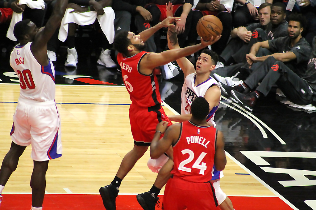 Austin Rivers tries to prevent Toronto Raptors guard Cory Joseph from getting to the basket in NBA preseason action at Staples Center on Wednesday, Oct. 5, 2016. Photo by Dennis J. Freeman/News4usonline.com