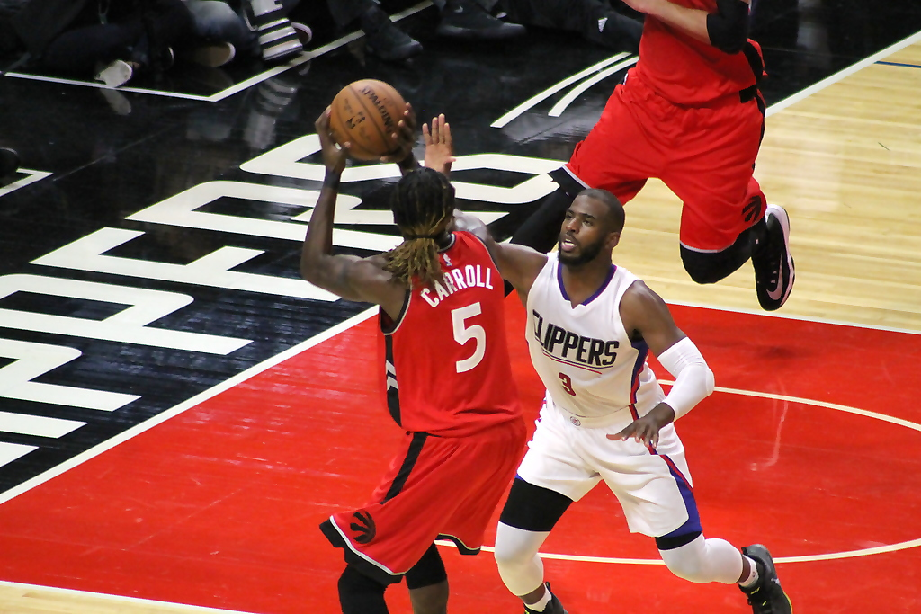Chris Paul make a defensive play on the ball against the Toronto Raptors in NBA preseason action at Staples Center on Wednesday, Oct. 5, 2016. Photo by Dennis J. Freeman/News4usonline.com