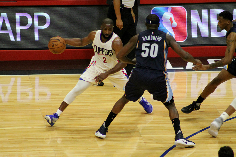 Raymond Felton looking to make a move past the Grizzlies' Zach Randolph. Photo by Dennis J. Freeman/News4usonline.com