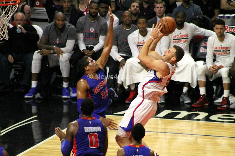 Blake Griffin gets this jumper off against a Detroit Pistons defender.
