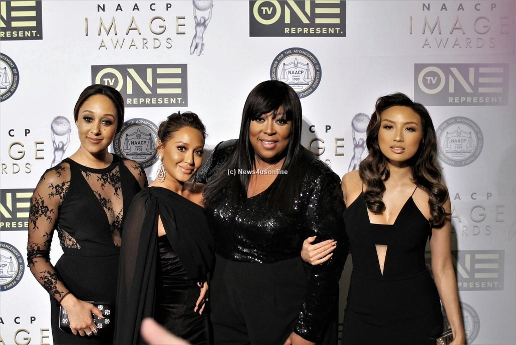 "Cast members from the talk show ""The Real"" all dressed in black on the red carpet at the 48th Annual NAACP Image Awards on Friday, Feb. 10, 2017. From left to right are Tamera Mowry-Housley, Adrienne Bailon, Loni Love and Jeannie Mai. Photo by Dennis J. Freeman/News4usonline"