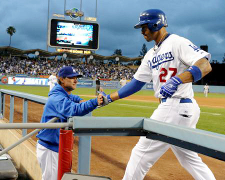 Los Angeles Dodgers Matt Kemp is greeted by Don Mattingly  after two run home run against the Milwaukee Brewers Tuesday, May 17, 2011 at Dodger Stadium in Los Angeles, California. Photo Credit: Jon SooHoo / Los Angeles Dodgers 2011